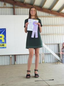 Brigid McGowan recived a Merit for the $15 Challenge and will be going to Clay County to model her outfit, which she purchased for $7