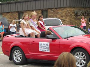 Little Miss Kingsley and her royal court ride in the parade