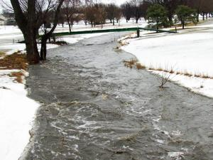The raging creek going through the golf course