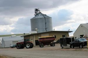 Tractor with a wagon load of corn coming into the elevator