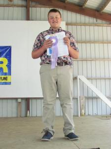Wyatt Nelson received a blue ribbon in Clothing Selection and will model his outfit at the Clay County Fair