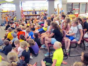 kingsley library kids watching magician